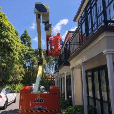 removing asbestos via mobile-boom-lift